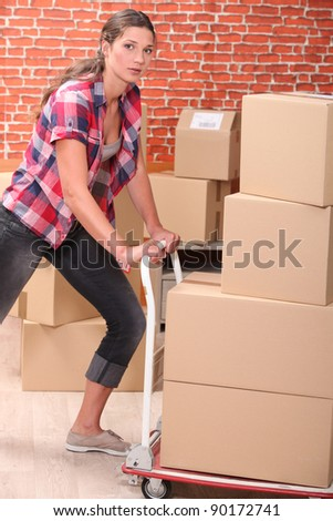 portrait of a woman with moving boxes - stock photo