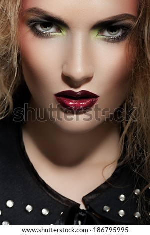 Portrait of a woman with red lips close-up - stock photo