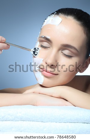 Portrait of a woman with spa mask on her face. Healthcare, medicine. - stock photo