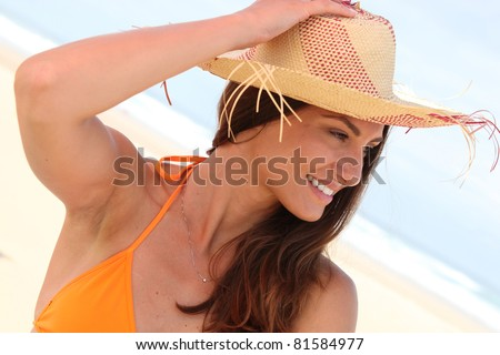 portrait of a woman with straw hat - stock photo