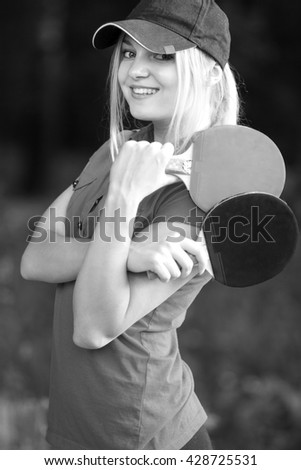 portrait of a woman with tennis racket - stock photo