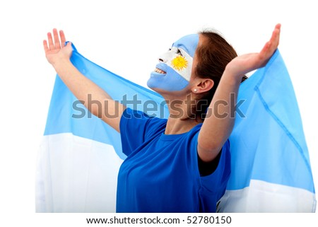 Portrait of a woman with the Argentinean flag painted on his face - stock photo