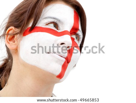 Portrait of a woman with the english flag paited on her face - over a white background - stock photo