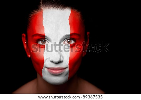 Portrait of a woman with the flag of the Austria painted on her face. - stock photo