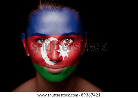 Portrait of a woman with the flag of the Azerbaijan painted on her face. - stock photo