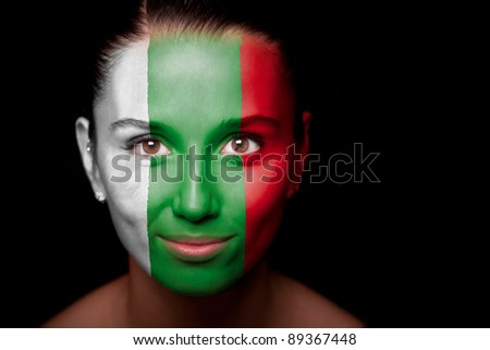 Portrait of a woman with the flag of the Bulgaria painted on her face. - stock photo