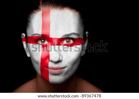 Portrait of a woman with the flag of the England painted on her face. - stock photo