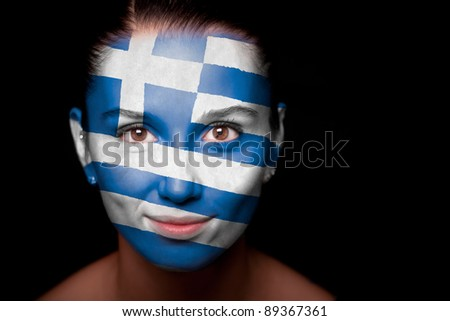 Portrait of a woman with the flag of the Greece painted on her face.