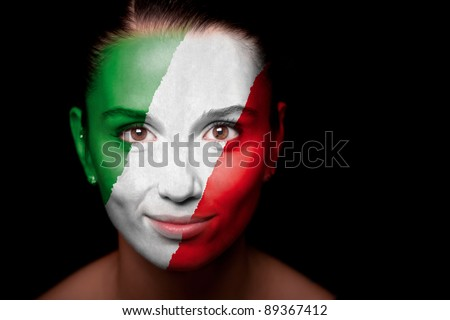 Portrait of a woman with the flag of the Italy painted on her face. - stock photo