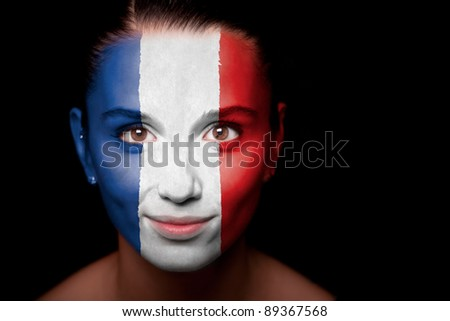 Portrait of a woman with the flag of the Netherlands painted on her face. - stock photo
