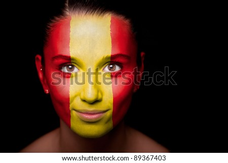 Portrait of a woman with the flag of the painted on her face. - stock photo