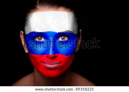 Portrait of a woman with the flag of the Russia painted on her face. - stock photo