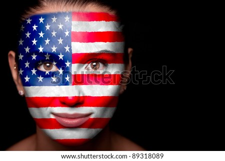 Portrait of a woman with the flag of the USA painted on her face. - stock photo