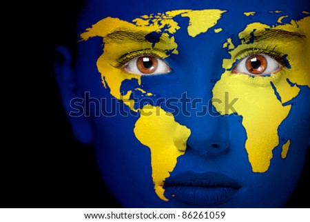 Portrait of a woman with the map of the world painted on her face. - stock photo