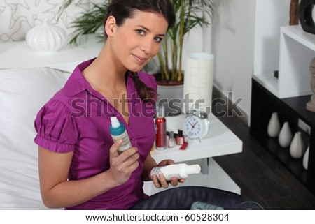 Portrait of a woman with toiletry kit