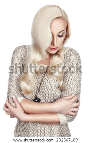 Portrait of a woman with wavy hair and bright make-up on white background. - stock photo