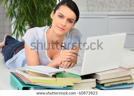 Portrait of a woman working in front of laptop computer