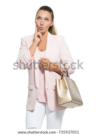 Portrait of a wondering happy woman with handbag. Pretty adult woman with surprise emotions