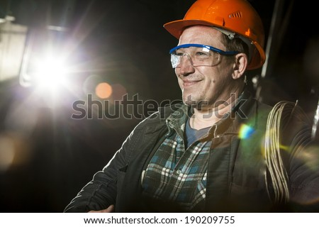 Portrait of a worker at the factory - stock photo