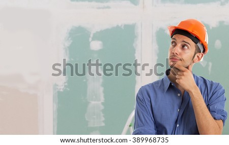 Portrait of a worker in an apartment. Large copy-space - stock photo