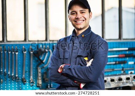Portrait of a worker in front of his tools - stock photo