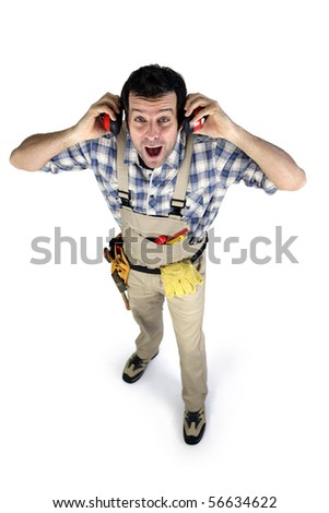 Portrait of a worker in overalls with noise-canceling headphones on white background - stock photo