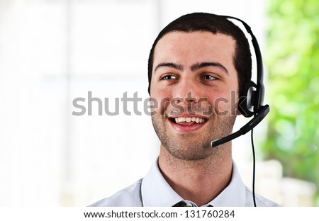 Portrait of a worker using an headset