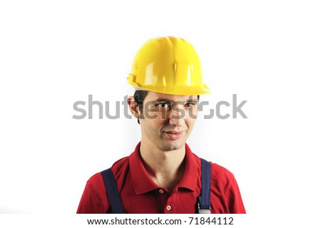 portrait of a worker wearing overalls - stock photo
