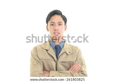 Portrait of a worker with his arms crossed - stock photo