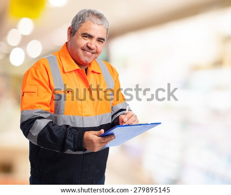portrait of a worker writing on a paper - stock photo