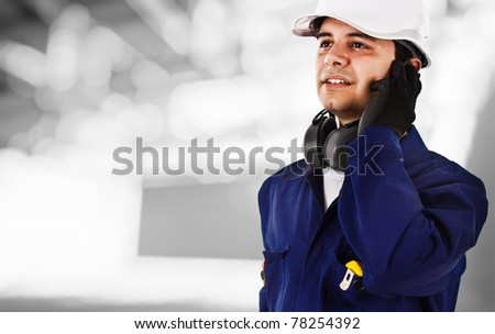 Portrait of a working engineer - stock photo