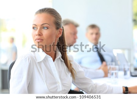 Portrait of a working woman thinking - stock photo