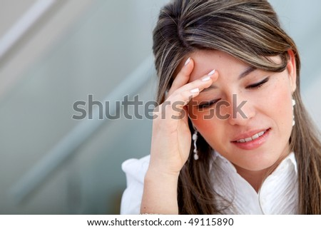 Portrait of a worried business woman at the office - stock photo