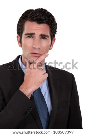 Portrait of a worried businessman - stock photo