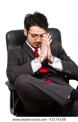 portrait of a worried businessman sitting on office chair - stock photo