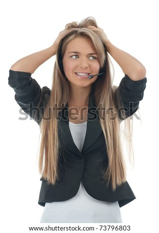 Portrait of a worried female call center employee wearing a headset, against white background - stock photo