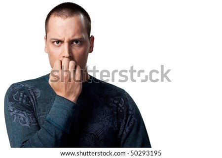 Portrait of a worried man, isolated in the studio - stock photo