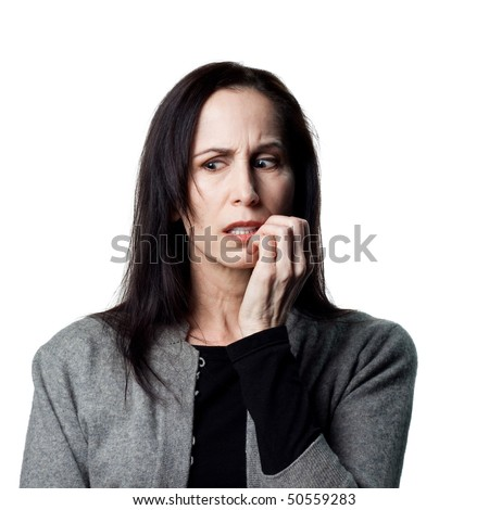 Portrait of a worried older lady, biting her nails