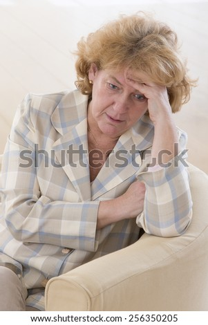 portrait of a worried woman with a sad expression - stock photo