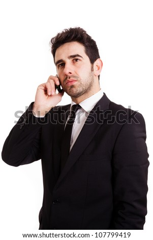 Portrait of a worried young business man with phone isolated on white background.