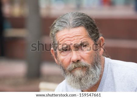 Portrait of a wrinkled and worried man - stock photo