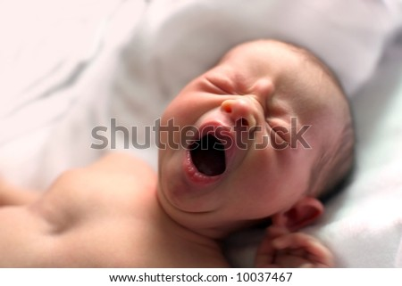 Portrait of a yawning baby - stock photo