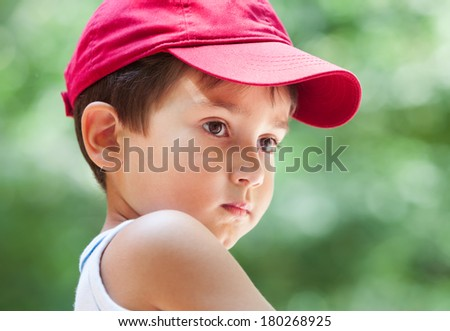 Portrait of a 3-4 years boy playing on soft nature background - stock photo