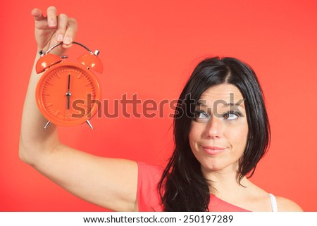 Portrait of a 30 years old on a orange background - stock photo