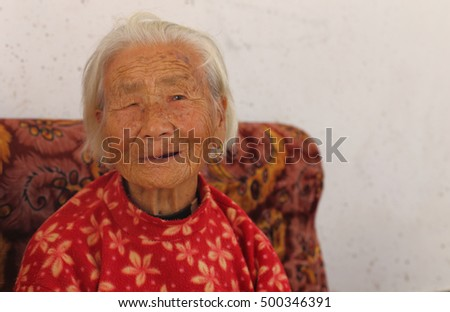 Portrait of a 97 years old woman, born in 1919, the last generation that bind the feet of woman