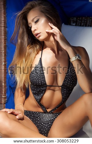 Portrait of a young adult attractive sexy and sensuality pretty beautiful brunette woman in black bikini and on the summer sunlight beach - stock photo