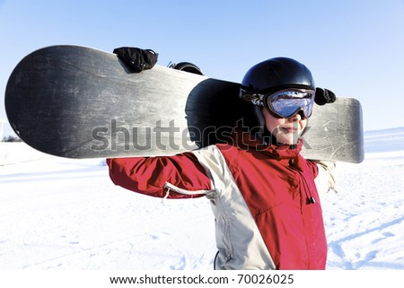 Portrait of a young adult female snowboarder - stock photo
