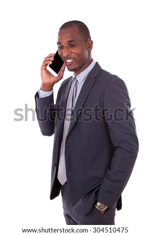 Portrait of a young African American business man making a mobile  phone call - Black people - stock photo