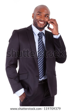 Portrait of a young African American business man making a phone call, isolated on white background - stock photo