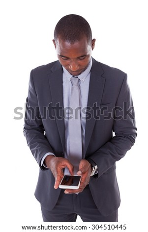Portrait of a young African American business man using a mobile phone - Black people - stock photo